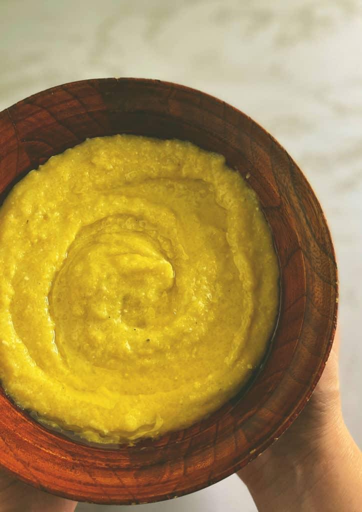 Creamy polenta in a wooden bowl