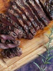 Flat iron steak on cutting board