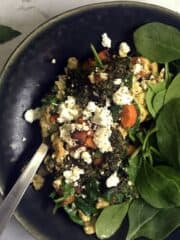 Scrambled Eggs with Pesto and Goat Cheese in a black bowl