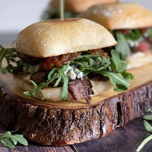 Steak Sliders with Blue Cheese on a wood board